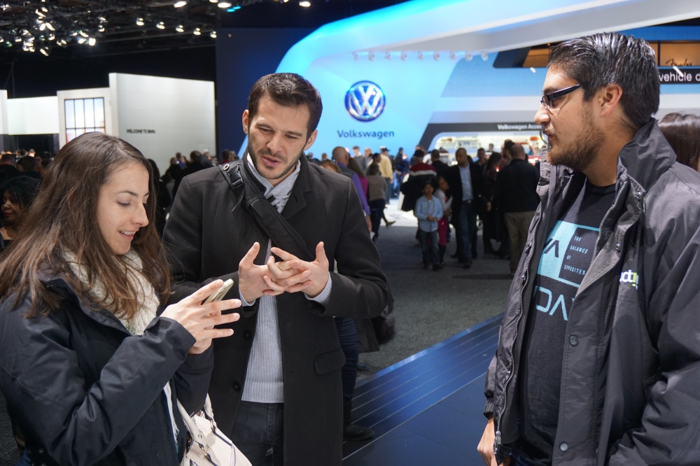 Left to right: Roselyn, Fabien, and Michal Flotron talking about the cars from the NAIAS 2016